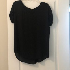 Short sleeved blouse with accordion pleat back